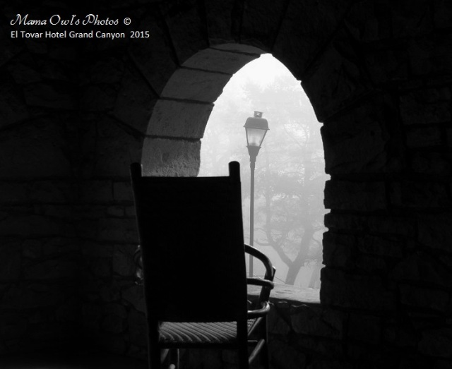 A chair facing a foggy window with lamp post at the El Tovar Hotel