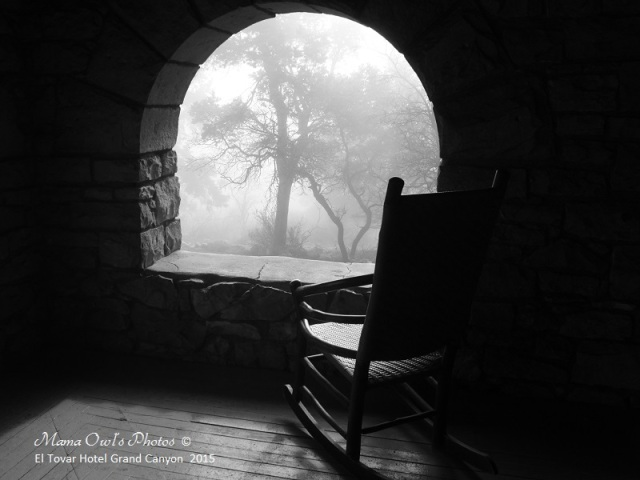 Black and white chair facing a foggy window at the El Tovar Hotel